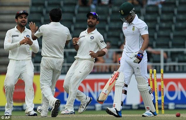 Fighting back: India's Virat Kohli celebrates with bowler Mohammad Shami for bowling JP Duminy