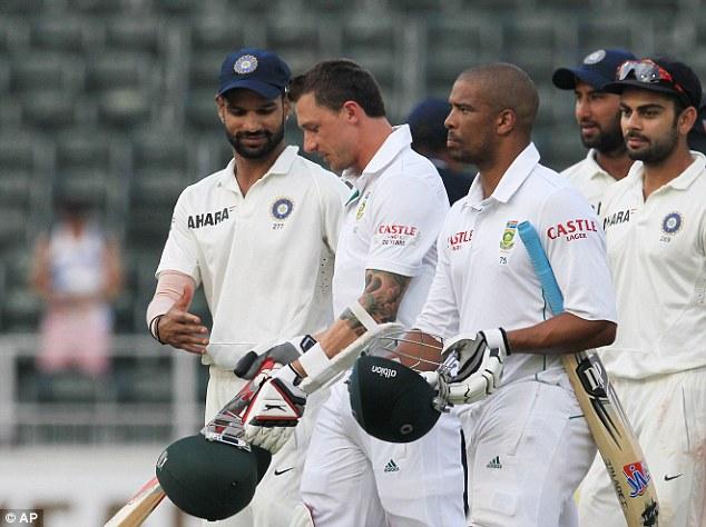 No winners: India's Shikhar Dhawan shakes hand with South Africa's batsman Dale Steyn