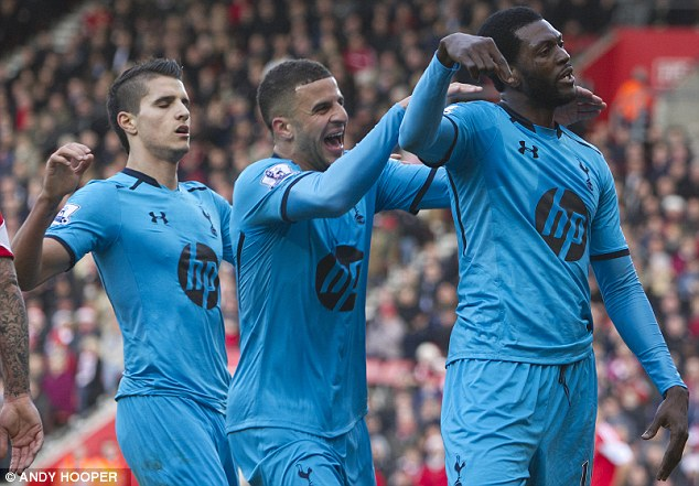 Start it up: Emmanuel Adebayor celebrates his goal after Lamela started the move on the edge of the box