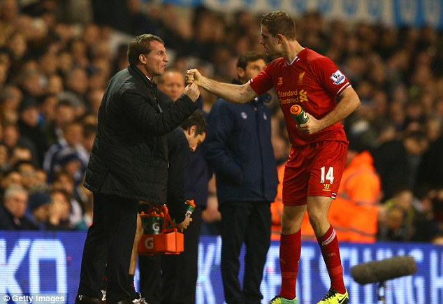 up there: Brendan Rodgers (left) has hailed the 'feelgood factor' created by Liverpool's recent results