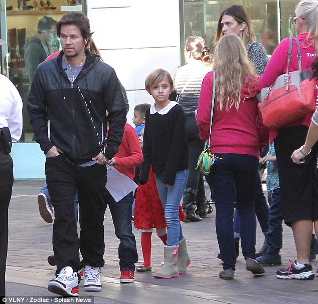 Getting in their lists: Mark Wahlberg, wife Rhea Durham and children Ella, 10, Michael, seven, Brendan, five, and Grace, three, visited Santa Claus at The Grove in Los Angeles, California, on Friday