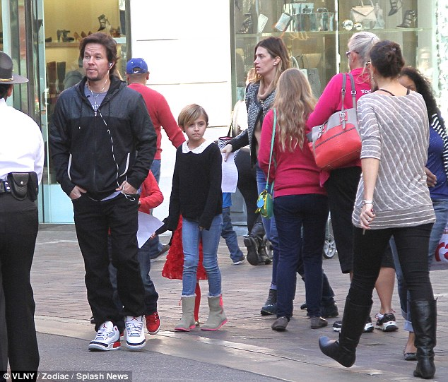 Hurry up kids: The Ted actor seemed in more of a rush to get to St Nick's house than his children