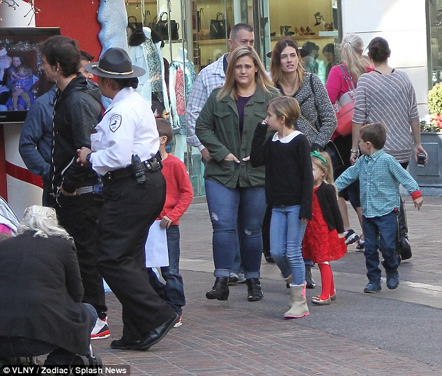 The seasonal treatment: The 42-year-old and his children were given the VIP treatment, allowing them to negotiate the packed mall with ease and avoid the pesky line to see the big man