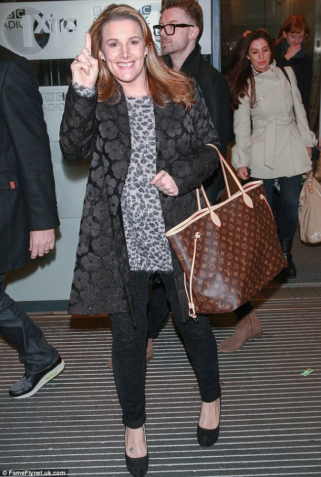 Eye-catching: The 36-year-old teamed her jacket with a long, grey leopard print jumper and matching, skinny jeans