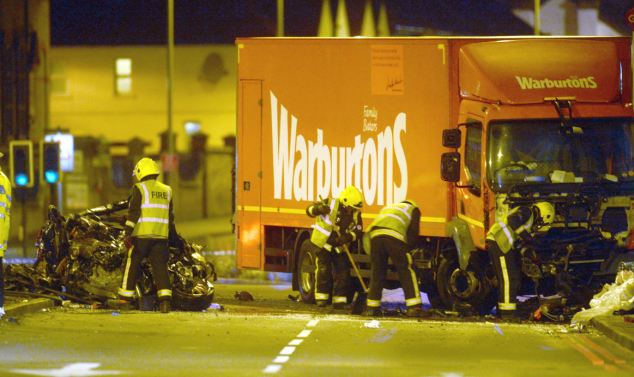 Tragedy: The remains of the car, left, and the lorry, right, could still be seen on the road until around 8am