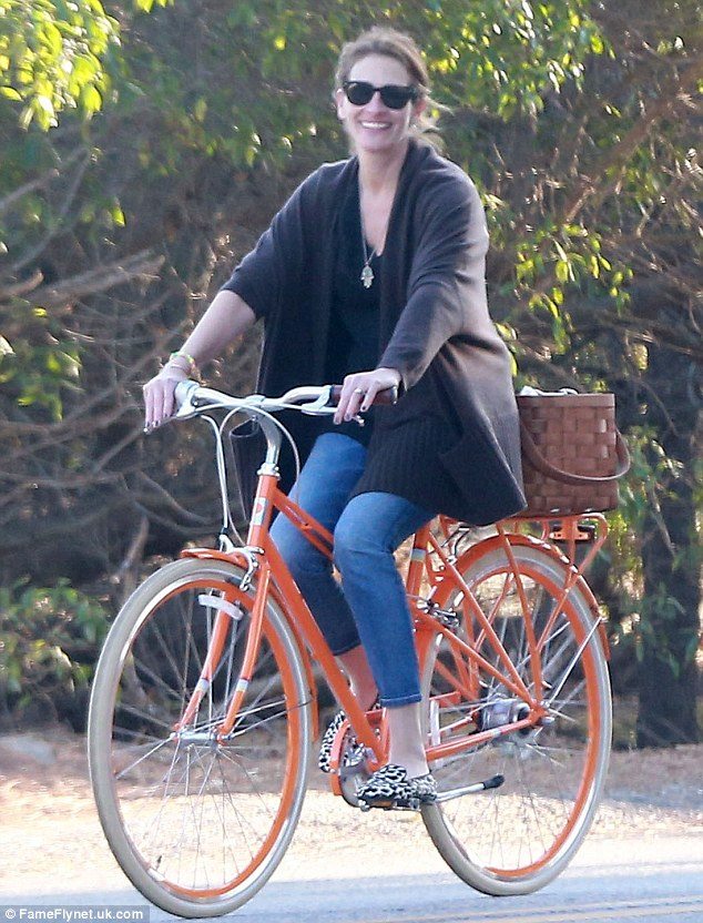 Bike beauty:  Julia Roberts enjoyed a family bike ride on Sunday in Malibu