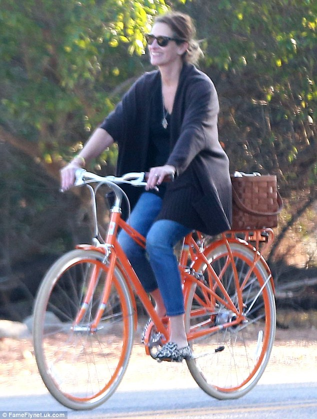 Content:  Julia looked the picture of happiness as she cycled along with her family around her