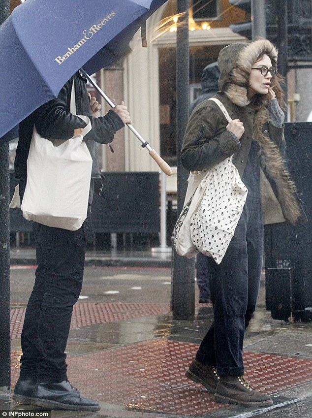 Keeping cosy: The actress looked cosy in her fur trimmed parka coat