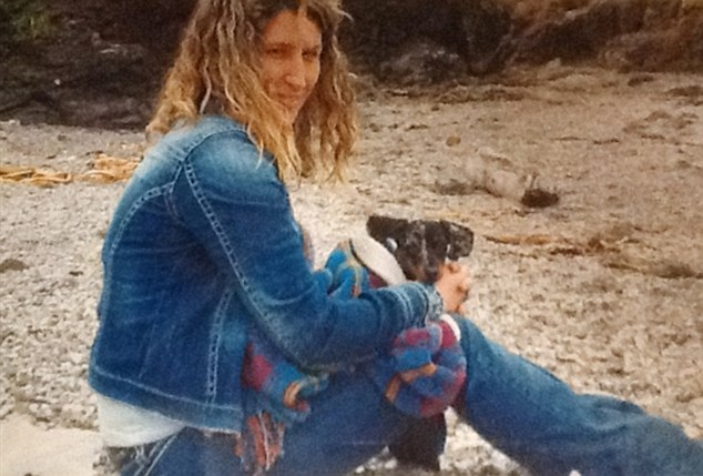 Missed: Sandra Miller is pictured here on Glass Beach in California with her dog a month before she was killed