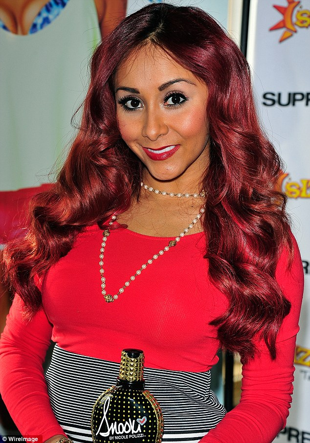 Hard at work: On Saturday Snooki made a personal appearance to promote her own line of self-tanning products in New Jersey on Saturday
