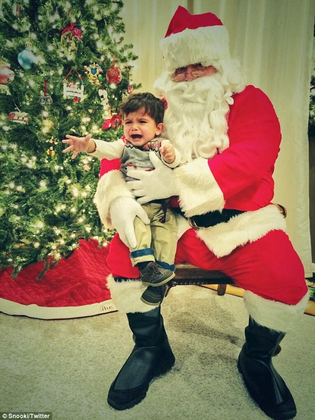 Scary Santa: Snooki posted a photo to her Twitter on Monday of her son, Lorenzo, sitting in Santa's lap and dissolving into tears as he reaches for  presumably, his parents