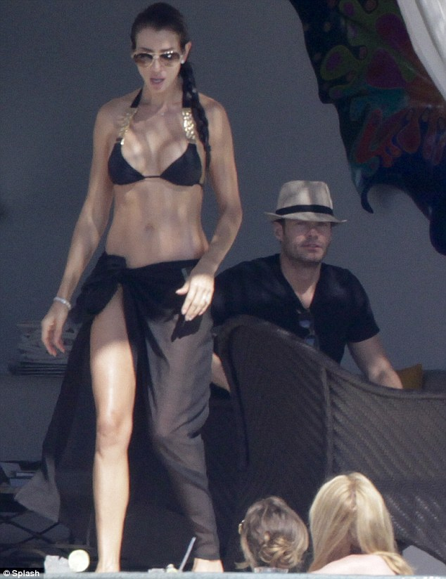 Getting an eyeful: Ryan Seacrest was spotted sneaking a cheeky glimpse of a woman's derriere in Mexico on Monday