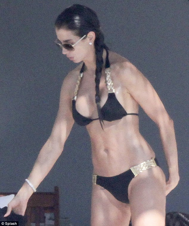 Flaunting her assets: The pretty brunette certainly seemed to enjoy flaunting her impressive bikini body
