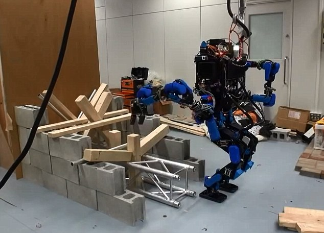 Clean-up: Another task required clearing debris from an entry way. DARPA said the motivated to do the competition are realizing how little robots were able to help during the 2011 Fukushima nuclear meltdown