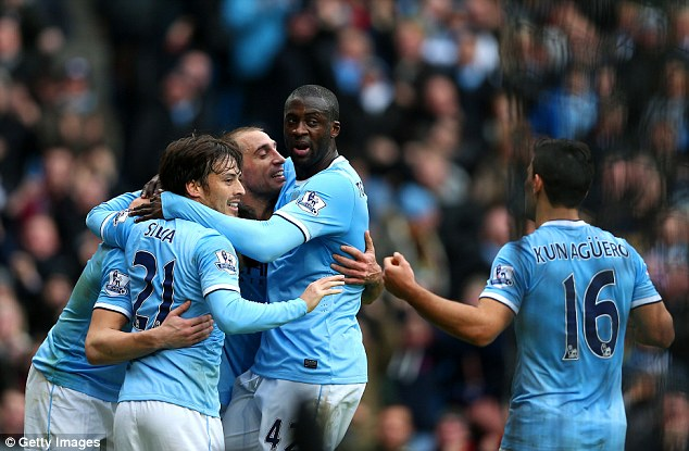 Goal surge: Manchester City have racked up a half-century of goals in the Premier League already this season