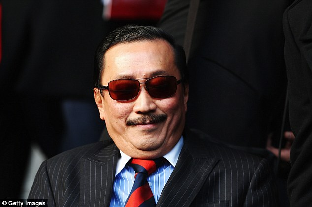Cardiff owner Vincent Tan watches Saturday's match at Liverpool