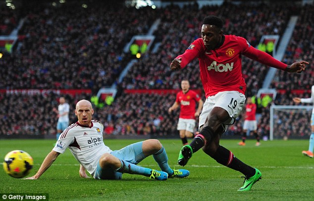 Out: Danny Welbeck, seen here scoring against West Ham, will miss out against Hull with a knee injury