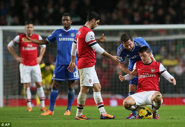 Night of toil: Mesut Ozil (right) struggled to make an impression in the drab 0-0 draw with Chelsea
