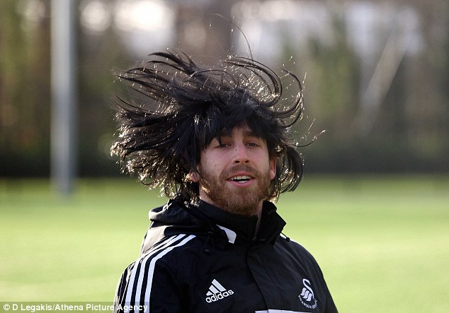 Larking around: Jose Canas wore black wig during Christmas Eve training with Swansea