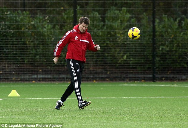 Still got it: Swansea manager Michael Laudrup shows off his skills during training