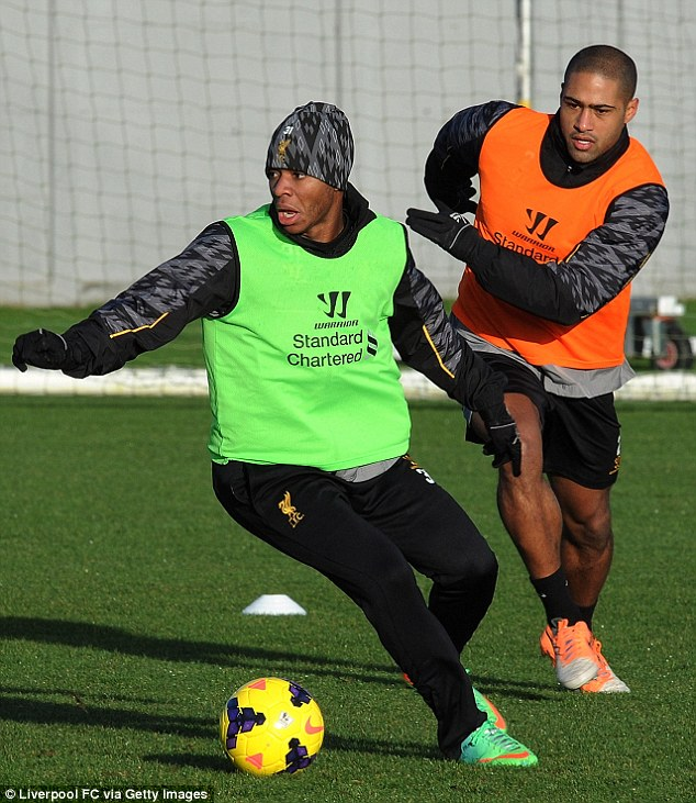 Contest: Raheem Sterling (left) tries to keep the ball from Glen Johnson during a training match