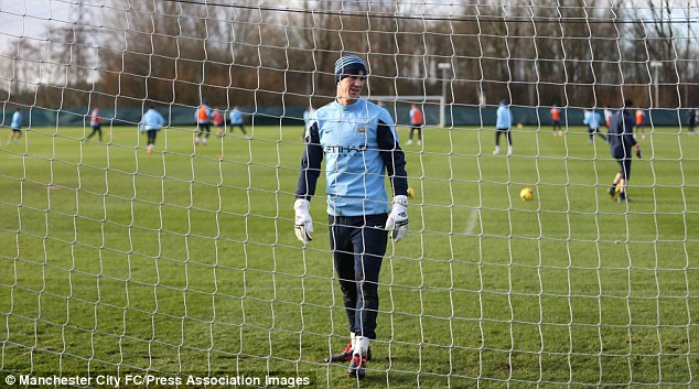 Shooting practice: Joe Hart was peppered by shots from City's potent strikeforce during training