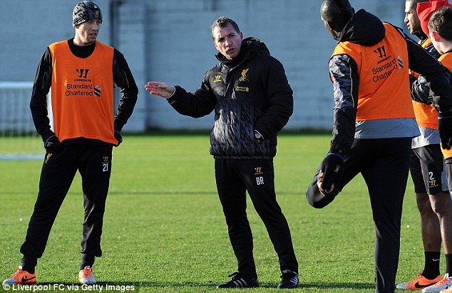 Have a dream: Rodgers takes Liverpool training on Christmas Eve, and insists Reds fans can dream of the title