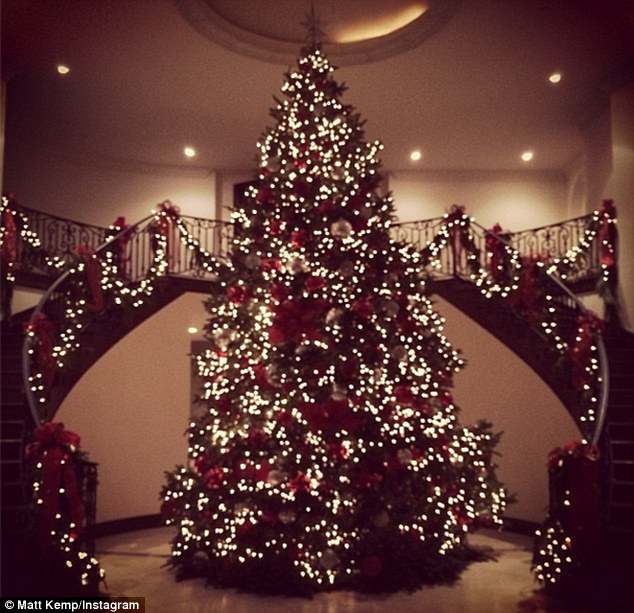 Impressive: This $2,000 Christmas tree has been decorated with red and gold