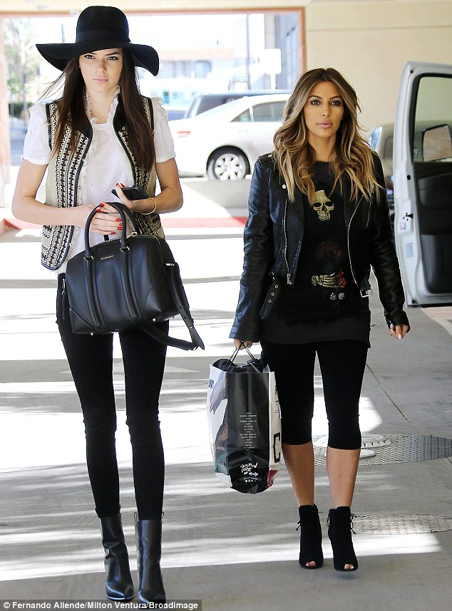 Doing good: Kendall (left) and Kim (right) stopped by a Children's Hospital in LA on Tuesday to cheer up a few tots