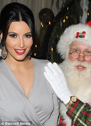 Kim is always there: On Santa's lap in 2011 (left) and with a friend in 2012 (right)