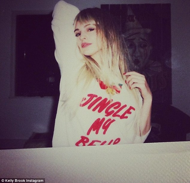 Cheeky: Kelly wore a jumper which read 'Jingle My Bells'