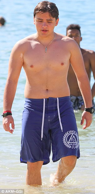 Staying fit: Prince wore a pair of blue swim trunks with the logo from his Brazilian jiu-jitsu school