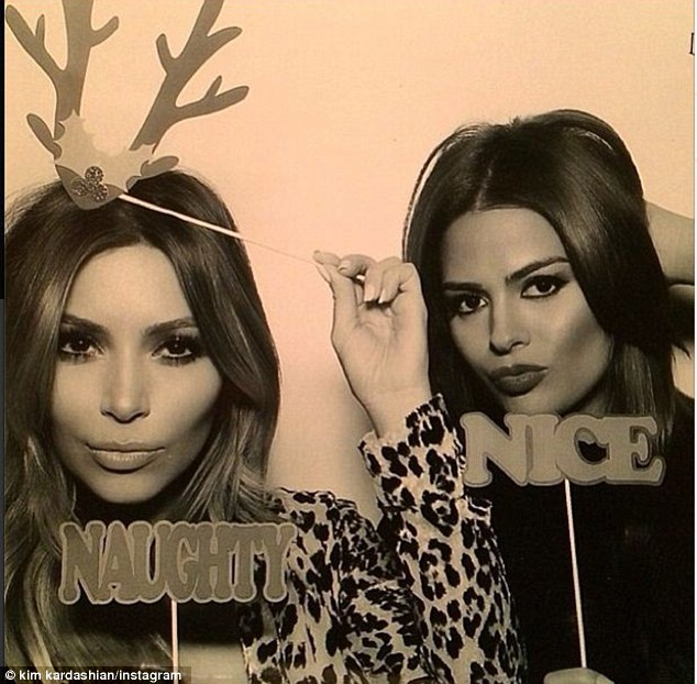 I'm a reindeer! Kim joked around as she posed with festive reindeer antlers on her head