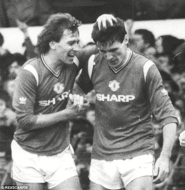 Back in his playing days: United's Bryan Robson and Frank Stapleton celebrate a goal in a thrilling 2-2 draw against Liverpool