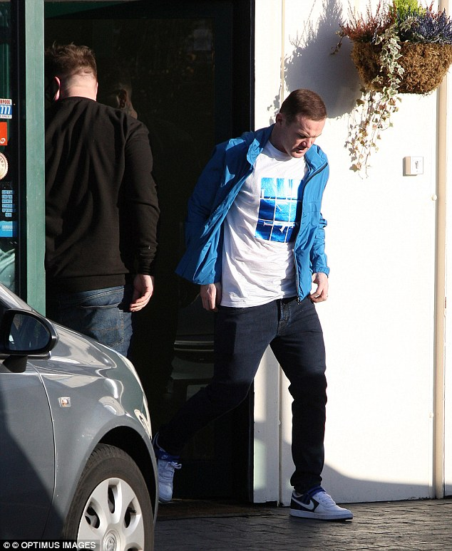 Keeping it casual: Wayne was dressed in a casual blue zipper, a white T-shirt, a pair of dark blue jeans and a pair of Nike trainers