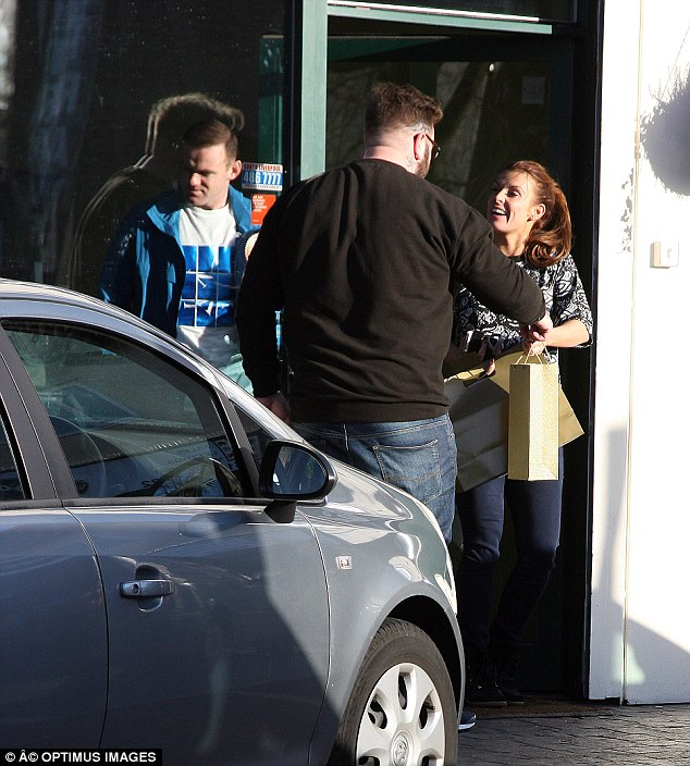 Spreading the festive joy! Wayne Rooney was spotted getting a haircut when Coleen arrived and was greeted with presents from the owners