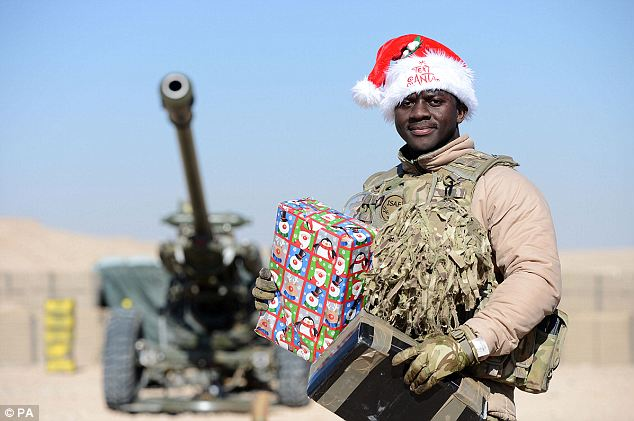 Love from far away: Lance Bombardier Julius Accu received his gift on Camp Bastion in Afghanistan just in time