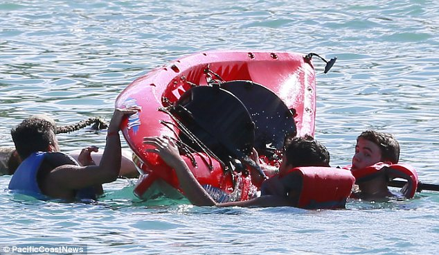 Overboard: Prince Michael and his pals took a tumble from their kayak but they were soon back on top