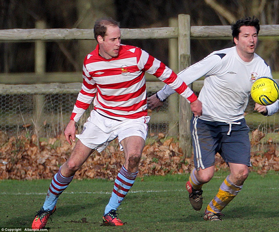 Eye on the ball: Prince William also got stuck into the annual fixture, and wore the socks from his beloved Aston Villa