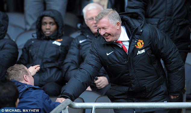 That's handy: Former Manchester United manager Sir Alex Ferguson was among the spectators in Hull
