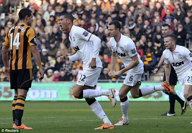 Back in the game: The United defender wheels away in celebration after scoring his side's opening goal