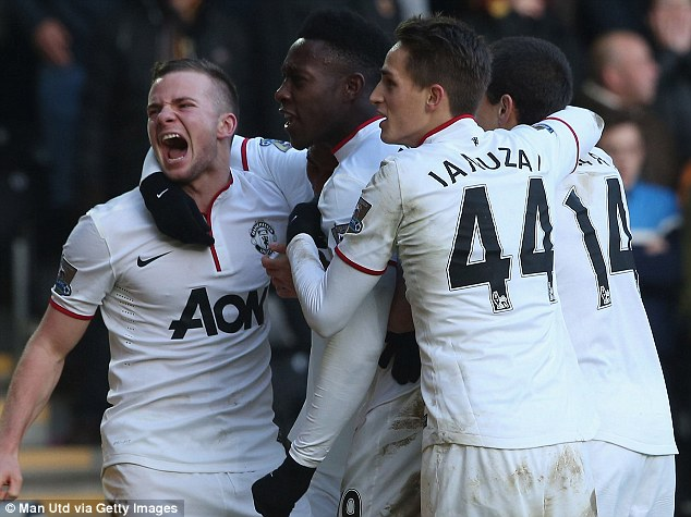 Time to celebrate: Man United have moved to within five points of leaders Liverpool having played a game more