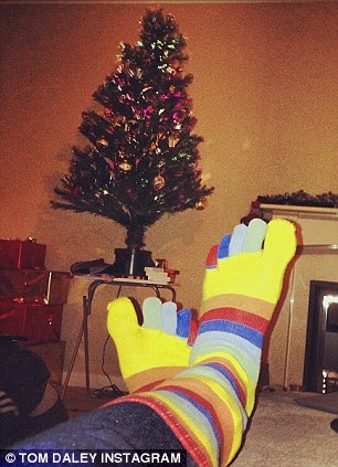 Socks appeal: Daley shows off a colourful Christmas gift