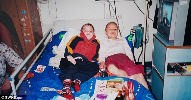 Daniel Kimmins in hospital with his friend Esme, in 2006