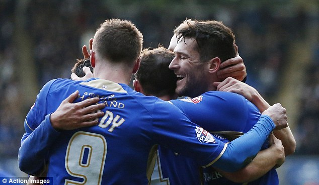 All together now: David Nugent celebrates with team mates after scoring the only goal for Leicester