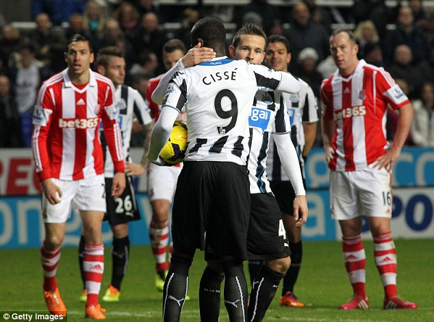 Generous: Yohan Cabaye gives the ball to Papiss Cisse to take a penalty against Stoke and break his drought