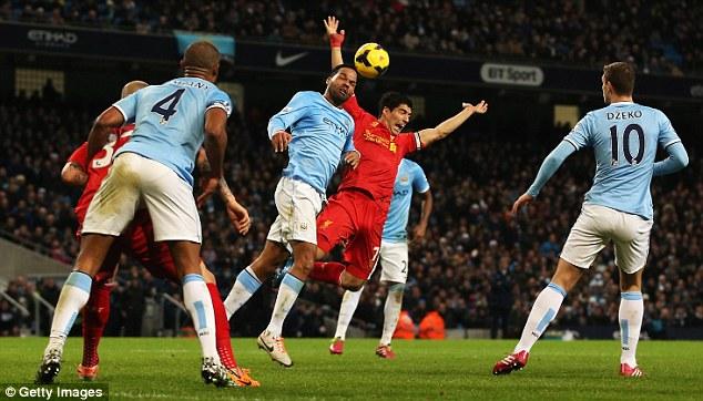 Going down: Luis Suarez felt he warranted a penalty following a tackle by Man City defender Joleon Lescott