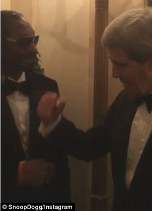 John Kerry and Snoop Dogg share a fist bump during a White House function