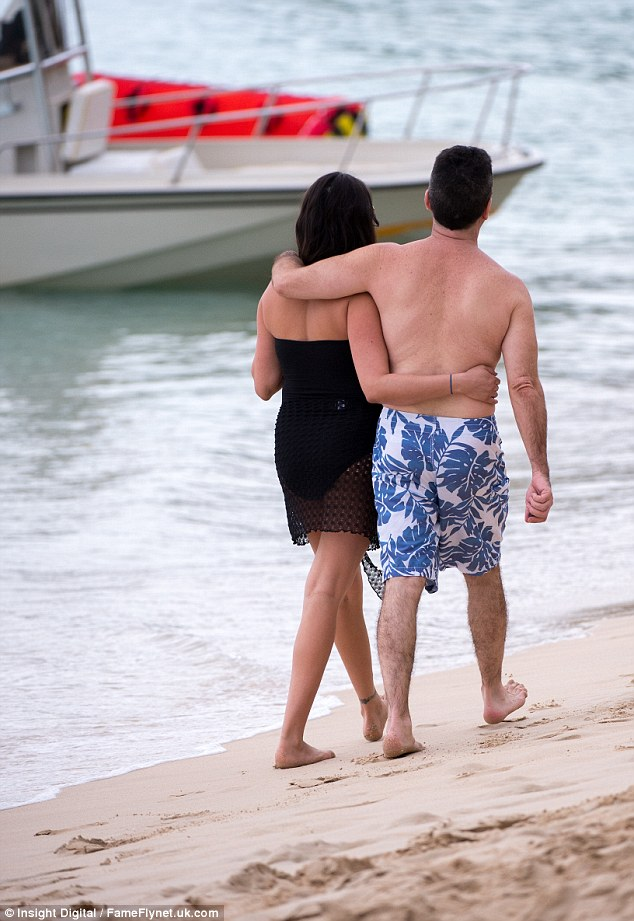 Such bliss: The pair took a romantic stroll and walked arm-in-arm