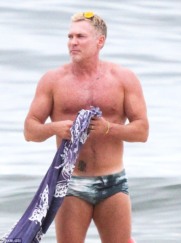 100% chance of abs! Weather anchor Sam Champion flaunted his incredibly buff bod at Ipanema Beach in Rio de Janeiro Thursday